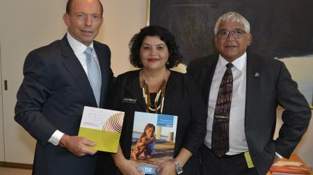 Close the Gap Campaign Co-Chairs Mick Gooda and Kirstie Parker exchange reports with Prime Minister Tony Abbott.