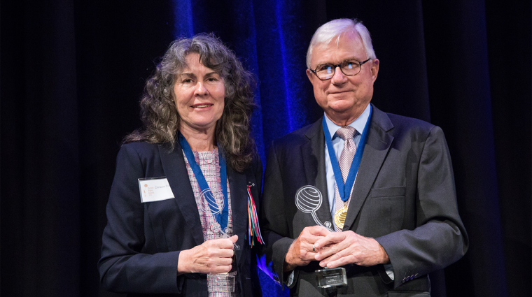 Chrissie Foster and the Honourable Justice Peter McClellan AM receive the Human Rights Medal in 2018.